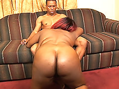 Red-headed black fatty rides every inch of his black cock