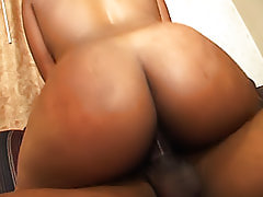 This big dark butt bounces all over the place, whether he's smacking it, fucking her doggy, or she's on top