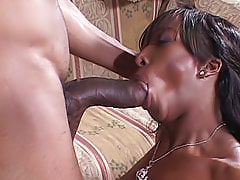 Streams of cum cover her sexy black face after he opens up her shaved pussy with it and fucks her on the couch