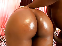 Her round black butt is oiled up, and then bent over to get fucked from behind before she swallows hot jizz