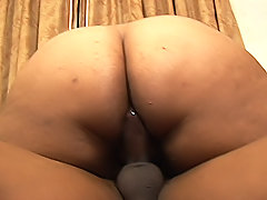 Large black ass sits right down on a dick