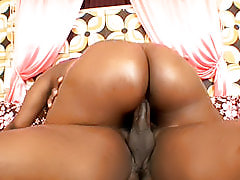With a big brown ass like Dominique Pleasures has, there's no dick that wouldn't get hard for her to get off
