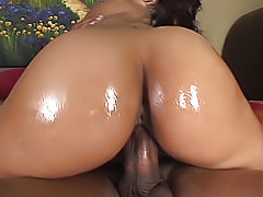 He shines that black butt up with oil, and then slides his big cock inside of her shaved fuck hole until he cums
