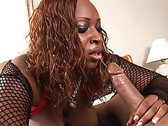 Black babe in fishnets sucks a cock and opens up her ass to get her large ass fucked hard